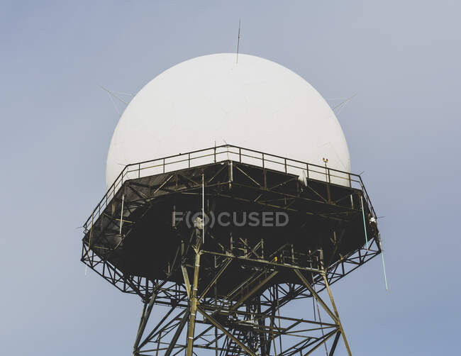 Domed radar antenna and tower, low angle view — Stock Photo