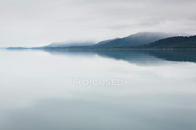 Overcast sky above calm water of an inlet in a national park. — Stock Photo