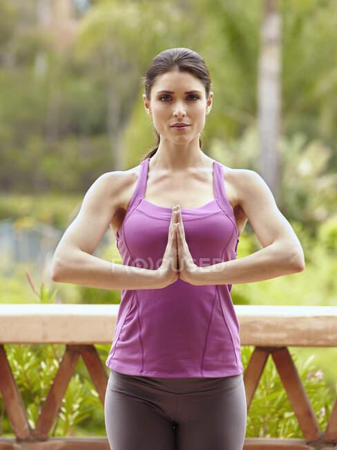 Beautiful young woman practicing yoga — Stock Photo