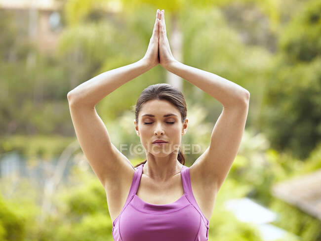 Beautiful young woman practicing yoga — Stock Photo