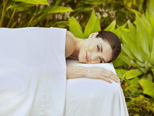 Caucasian woman waiting for massage — Stock Photo