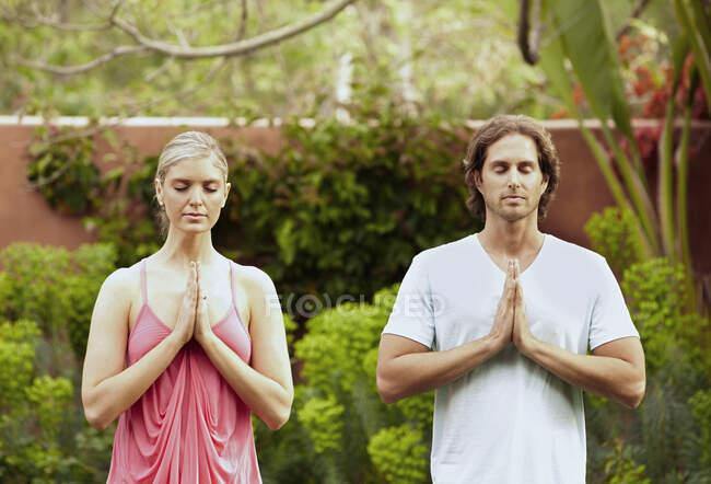Caucasian couple practicing yoga — Stock Photo