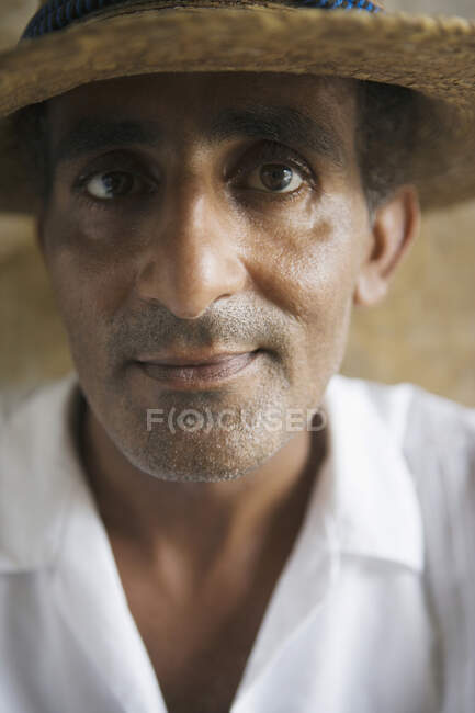 Close up portrait of middle aged man in hat looking at camera, selective focus — Stock Photo