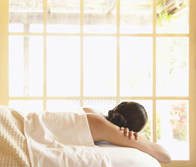Rear view of woman lying on massage table at a luxury spa in wine country — Stock Photo