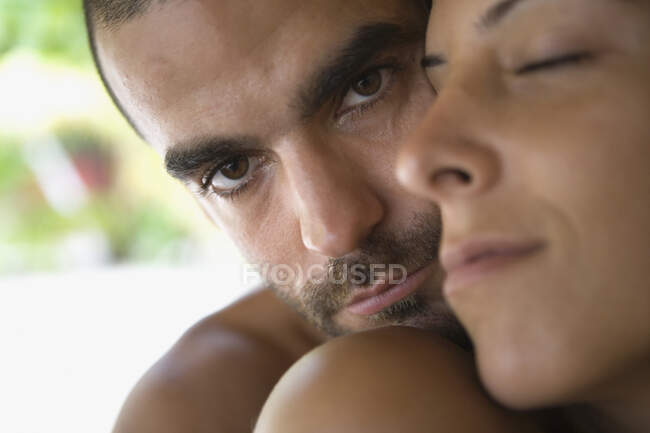 Young couple hugging, close-up view — Stock Photo