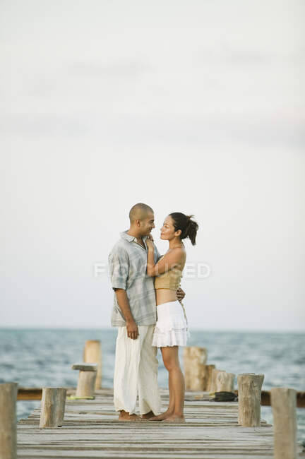 Couple hugging on a pier — Stock Photo