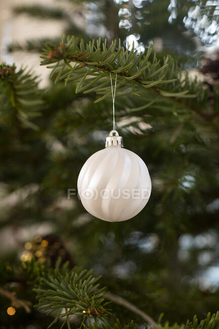 Close up of white bauble on Christmas Tree. — Stock Photo
