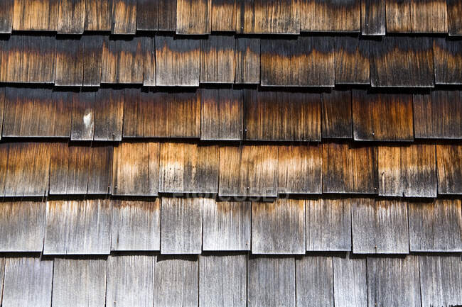 Close up of wooden shingles on the side of a building — Stock Photo