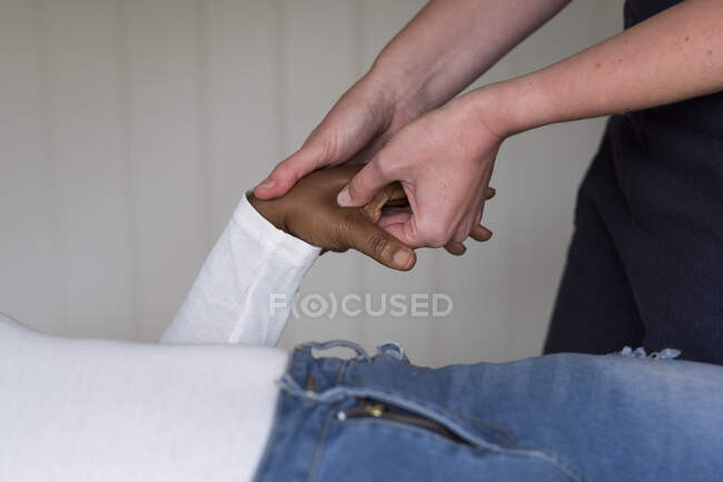 Therapist touching a client hands. — Stock Photo