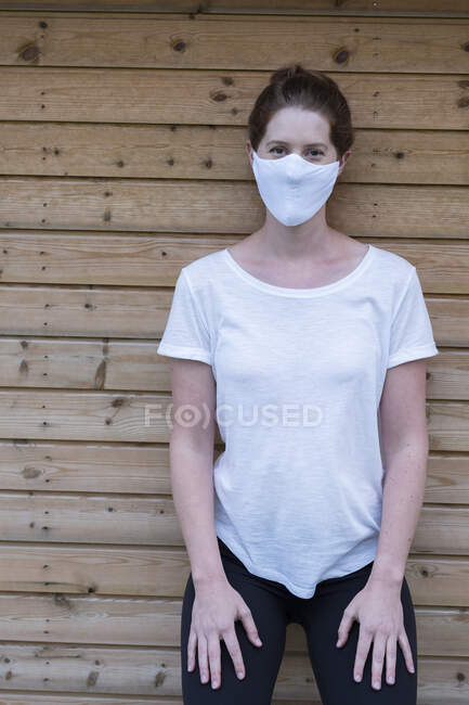 Portrait of woman wearing white face mask — Stock Photo