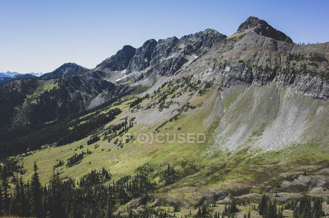 View of the North Cascade Range across a valley on the Pacific Crest Trail — Stock Photo