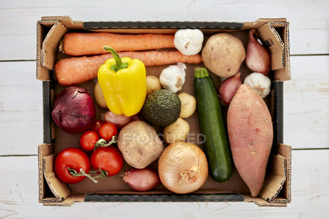 Box of fresh organic vegetables, close-up view — Stock Photo
