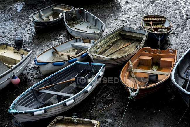 High angle view of fishing boats moored in harbour at low tide. — Stock Photo