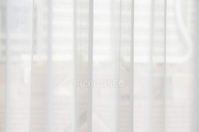Translucent window blinds or curtains on window — Stock Photo