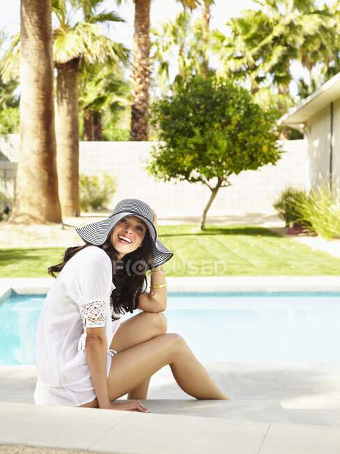 Young hispanic woman in a white shirt over her bikini. — Stock Photo