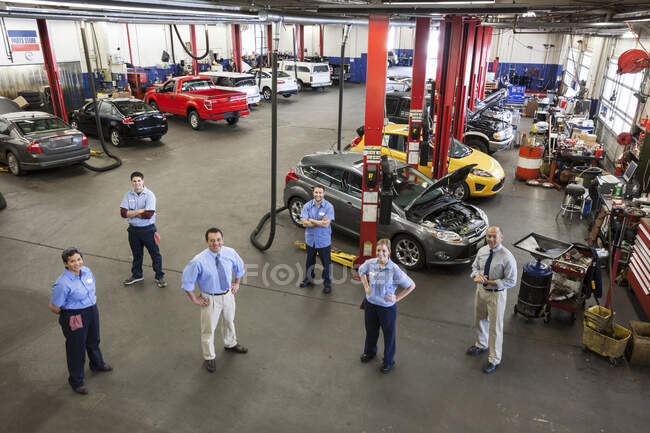 Portrait of Six Mechanics in Auto Repair Shop viewed from above — Stock Photo