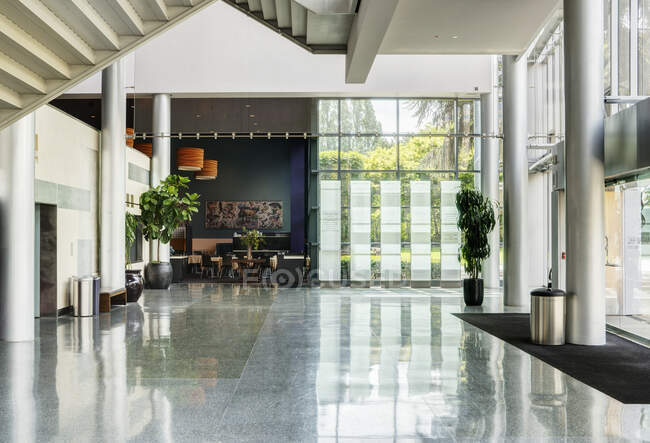 Light and airy atrium of a modern building with marble floors. — Stock Photo