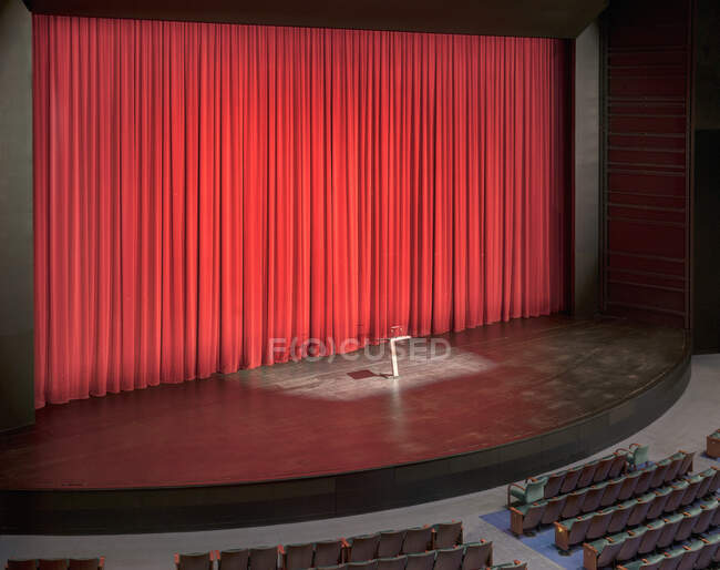 Stage with red curtains in an empty auditorium. — Stock Photo