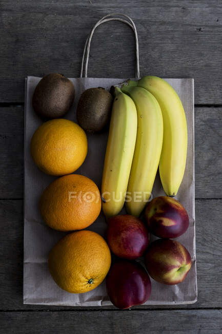 High angle close up of selection of freshly picked and exotic fruits. — Stock Photo