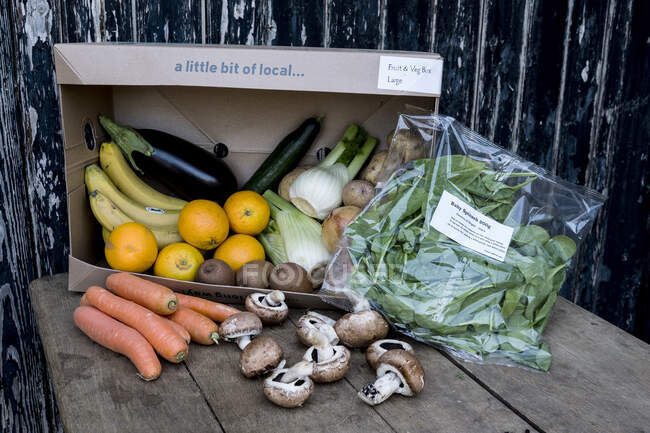 Close up of an organic fruit and vegetable box with a selection of fresh produce. — Stock Photo