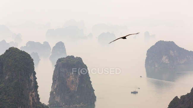 Aerial view over misty Ha Long Bay, North Vietnam — Stock Photo