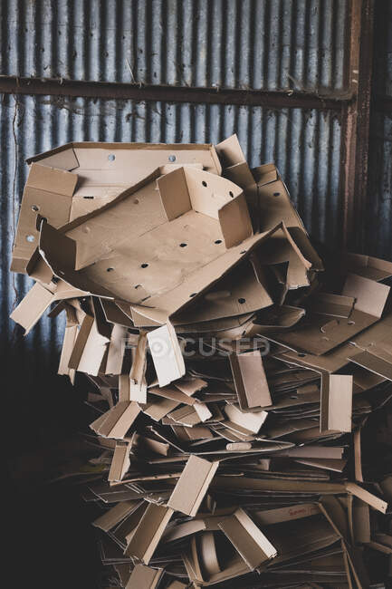 Close up of heap of crumpled cardboard boxes on a farm. — Stock Photo