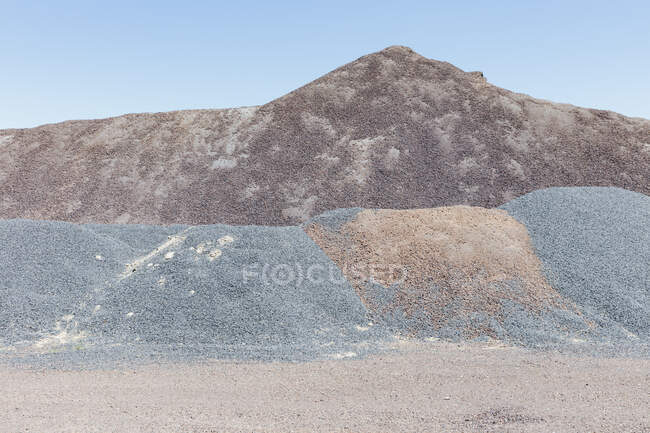 Gravel piles used for construction and road maintenance — Stock Photo