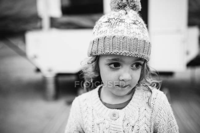 Cute girl wearing knit hat — Stock Photo