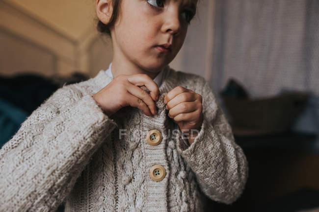 Cute girl in woolen jacket — Stock Photo