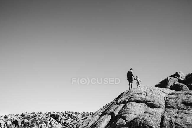 Father with son standing on rock foundation — Stock Photo