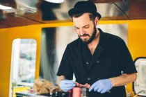Man cook preparing food in food truck — Stock Photo