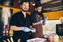 Men cooks preparing food — Stock Photo