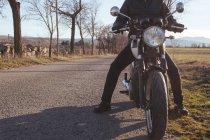 Retro motorcycle and man — Stock Photo