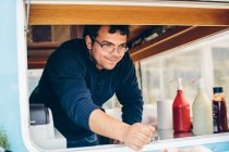 Young man in food truck — Stock Photo