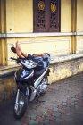 Man sleeping on scooter — Stock Photo