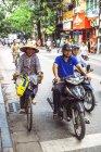 People on motorbikes and bikes in Hanoi — Stock Photo