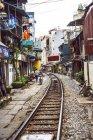 Houses on railway track in Hanoi — Stock Photo
