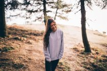 Attractive brunette young girl in forest — Stock Photo