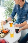 Man and woman tasting beer — Stock Photo