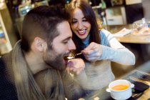 Young couple eating in restaurant. — Stock Photo