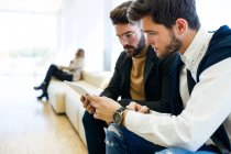 Young businessmen in modern office. — Stock Photo