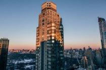 Skyscrapper tower in sun light — Stock Photo