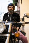 Brutal man on classic bike — Stock Photo