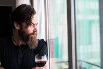 Thoughtful man with wine glass — Stock Photo