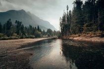 Water flowing calmly in mountain valley — Stock Photo