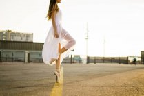Low section of ballet dancer at city square — Stock Photo