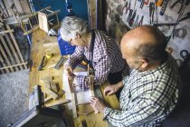 High angle view of senior couple working at workshop — Stock Photo