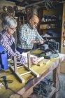 Senior couple working at carpenter workshop — Stock Photo