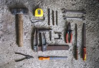 Directly above view of carpenter tools on concrete surface — Stock Photo