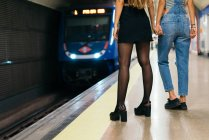 Girlfriends waiting for train — Stock Photo